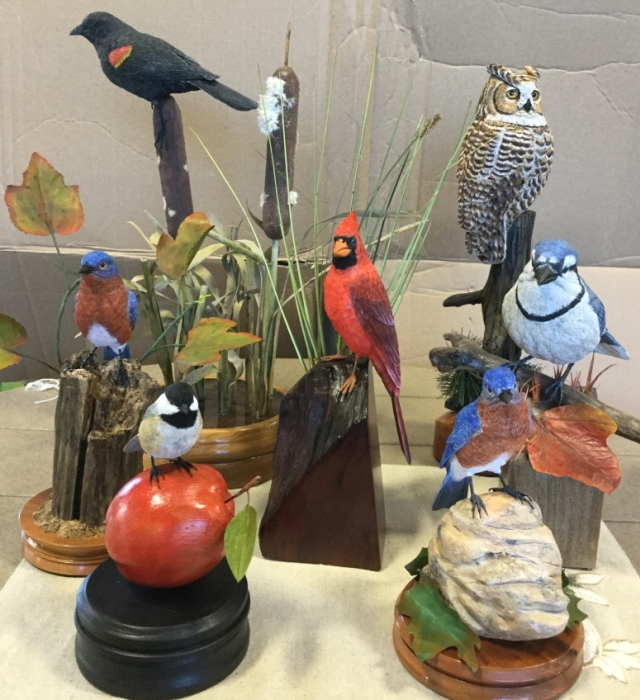 hand carved and painted birds